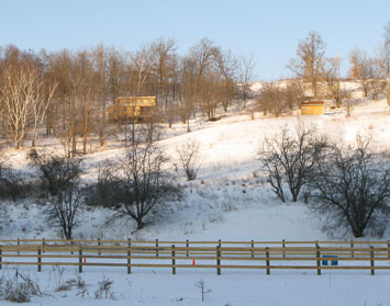 Fence & cabin in snow