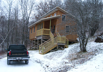 cabin with snow dusting